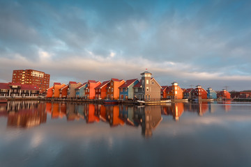 colorful buildings on water in morning sunlight