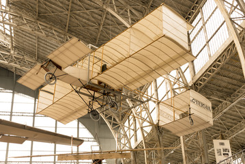 Vintage Airplane Inside A Hangar and Holding from the Roof