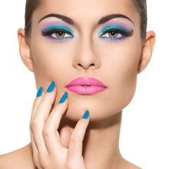Beautiful girl with colorful makeup