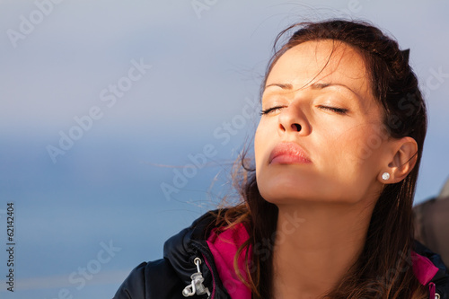 Beautiful lady enjoying on a sailboat.Copy space