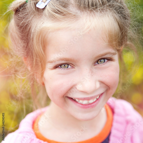 Portrait of a happy little cute girl