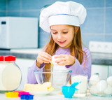 Cute little girl preparing cookies