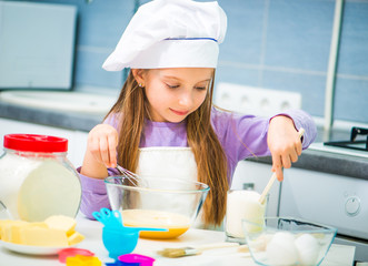 little girl preparing cookies