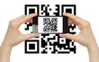 Hands hold smart phone with QR code on white background .