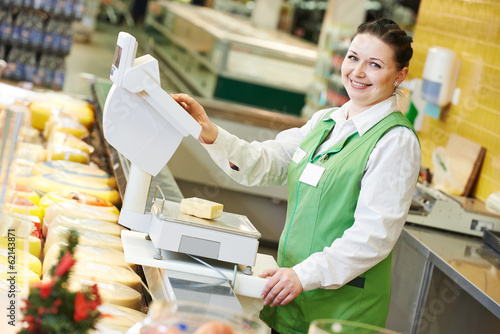 saleswoman in supermarket shop