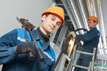 two electrician worker at cabling
