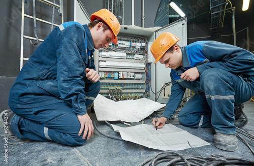 Leinwanddruck Bild two electrician workers