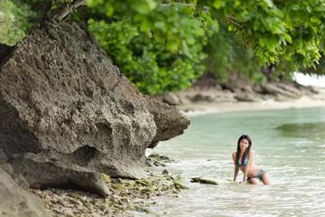 Woman swimming on a beautiful lush seashore