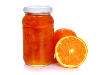 Jar of orange marmalade and oranges