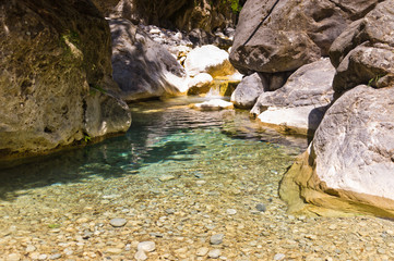 Mountain creek through Samaria gorge, island of Crete