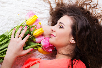 Happy girl with tulips. Spring time