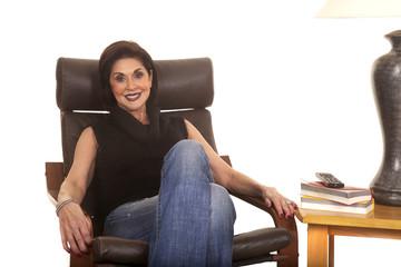 older woman black top sit chair smile