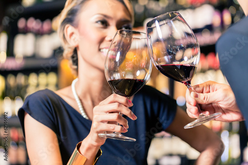 Asian couple drinking red wine