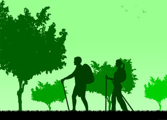 Hiking couple with rucksacks in park silhouette