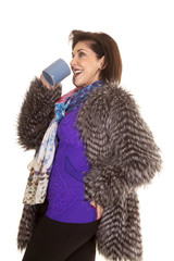 woman fur coat drink from mug