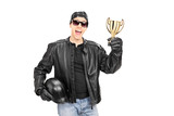 Male biker with headscarf holding a trophy
