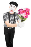 Male mime artist holding a bouquet of flowers