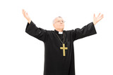 Priest in black mantle gesturing with hands