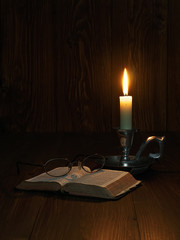 Reading by candlelight