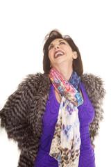 woman purple shirt fur coat laugh
