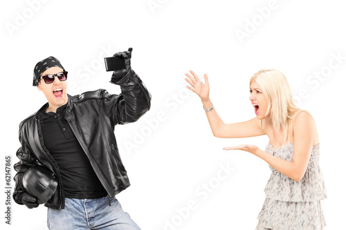 Mad woman yelling at her biker boyfriend