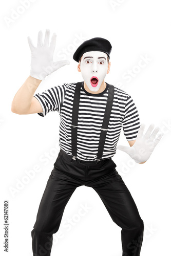 Male mime artist performing isolated on white background