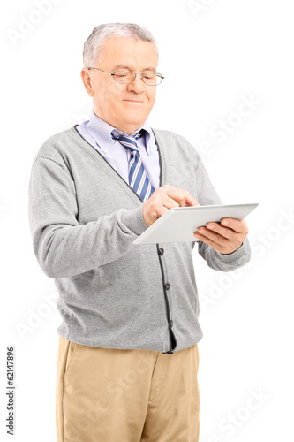 Senior gentleman working on a tablet