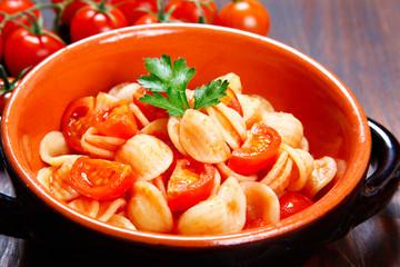 orecchiette pasta with tomato sauce.