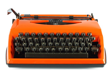 Vintage typing machine on white background .