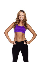 Beautiful young fitness woman. Isolated over white background