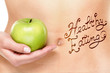 Healthy eating concept - woman stomach and apple