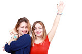 Two happy girls gesturing, with copy space