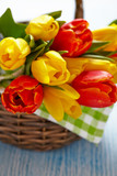 Red and yellow tulips in a basket