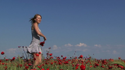 Rejoicing woman in a field of poppies