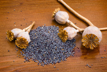 poppy seeds on wooden table