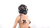 sexy woman with beautiful body dances with a gas mask
