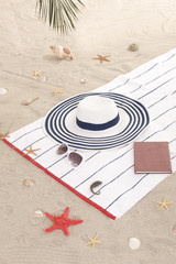 beach items on sand for fun summer holiday