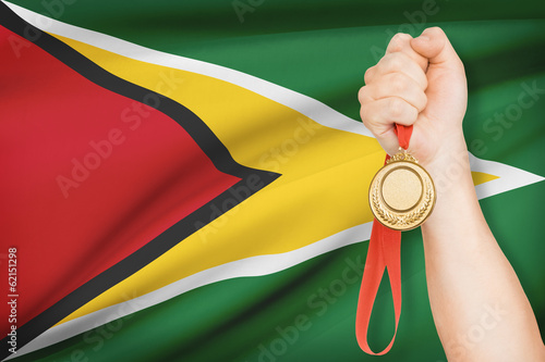 Medal in hand with flag - Co-operative Republic of Guyana