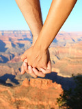 Couple holding hands hiking romantic, Grand Canyon