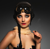 Portrait of a beautiful woman aviator with a glamorous retro mak