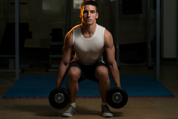 Squats With Dumbbells