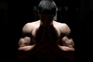 Muscular Man Praying