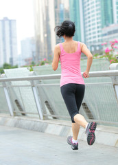 healthy lifestyle woman running at city