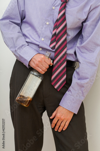 Drunk businessman with a bottle