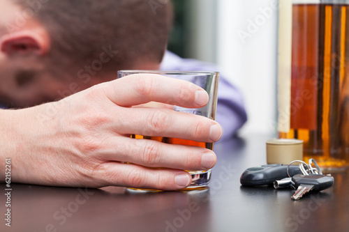 Drunk driver sleeping on table