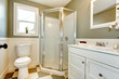 Great blend of white bathroom cabinets with olive walls.