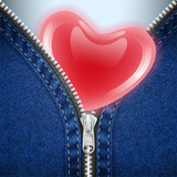 Denim background with open zipper and red heart