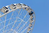 ferris wheel in the park with clear blue sky and empty space for