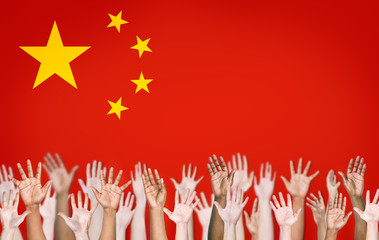 People's Hands Raised with Chinese Flag