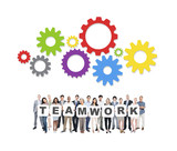Multi-Ethnic Group Of People Holding The Word Teamwork